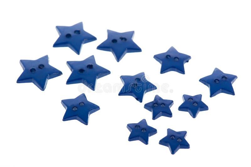 Parecchi bottoni del blu nella forma della stella immagine stock