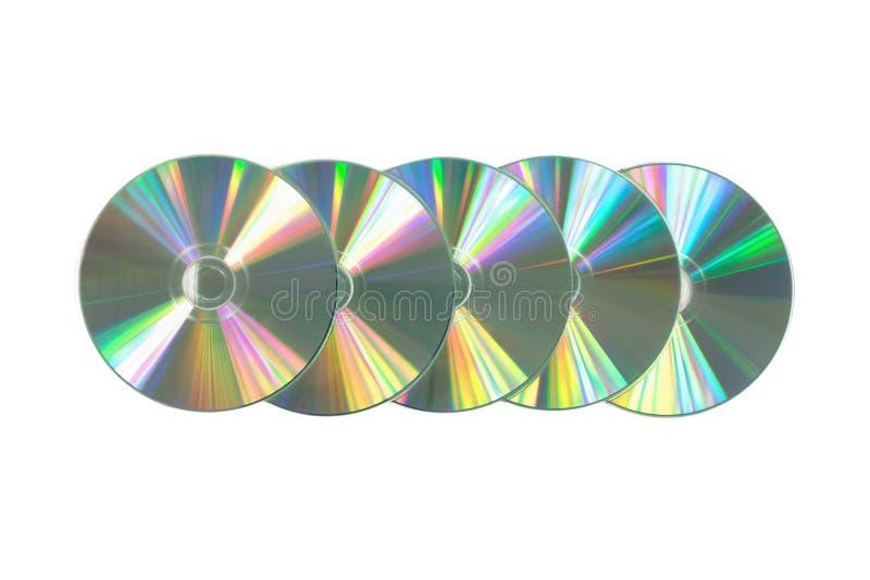Parecchio CD/DVD su fondo bianco isolato immagine stock libera da diritti