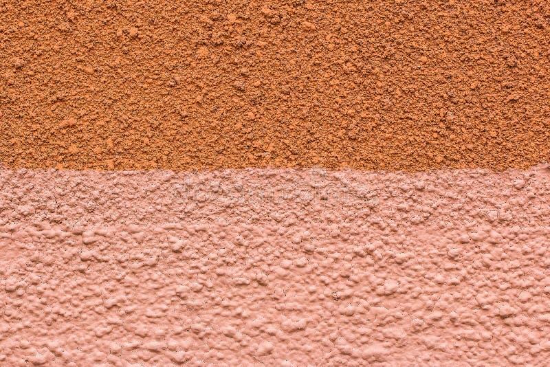 Pared áspera de colores rojos y rosados como textura Los fondos concretos de la pared texturizaron fotografía de archivo