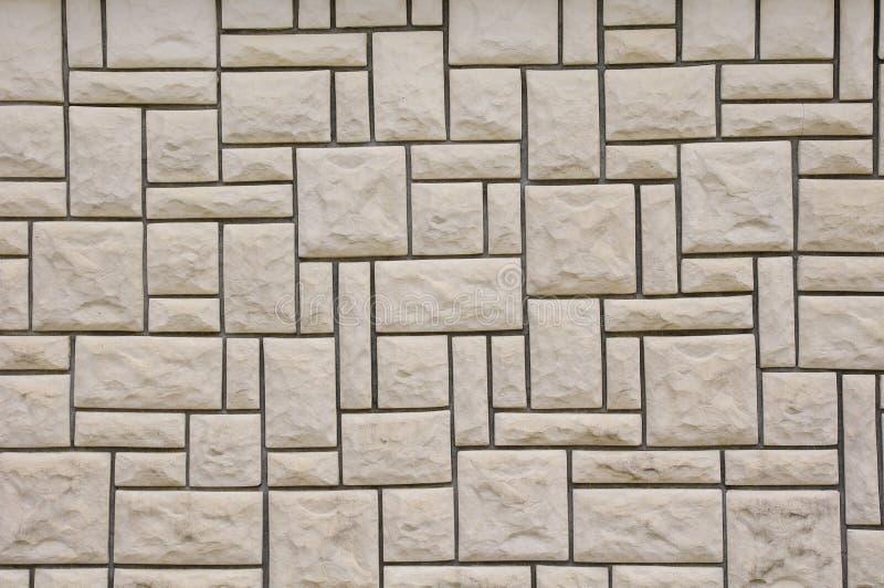 Pared alineada con las losas de piedra imagen de archivo for Losas de pared
