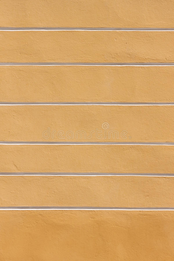 Pared amarilla de la raya imagen de archivo libre de regalías