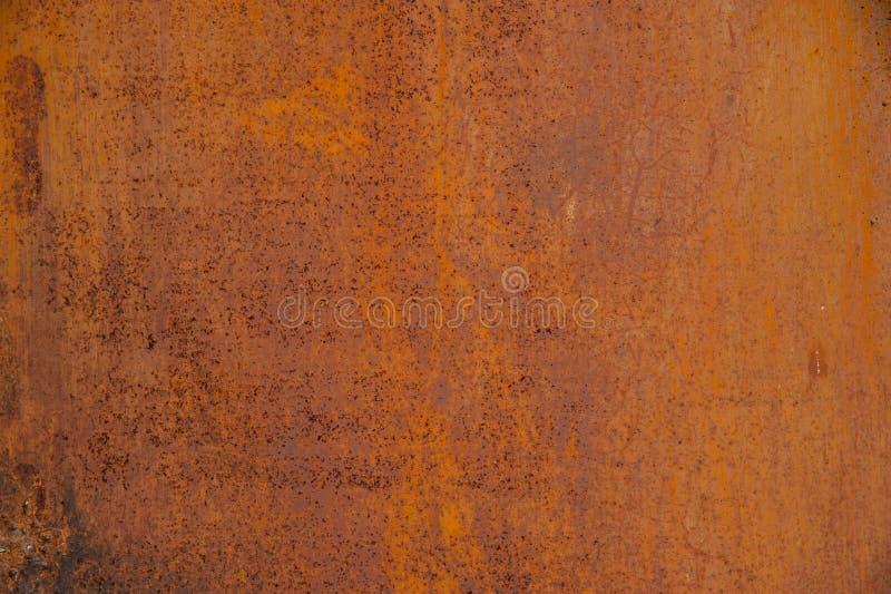 Pared anaranjada rasguñada extracto del fondo del grunge foto de archivo