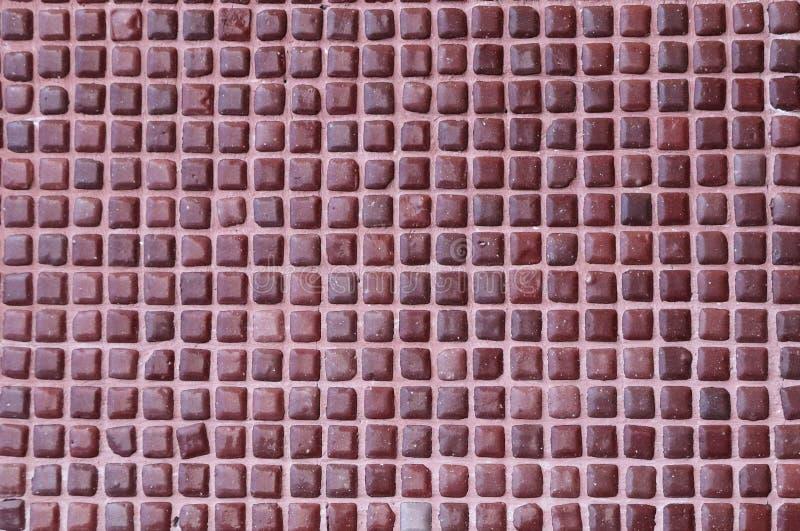 Pared con azulejos cuadrados de color marrón imagen de archivo libre de regalías