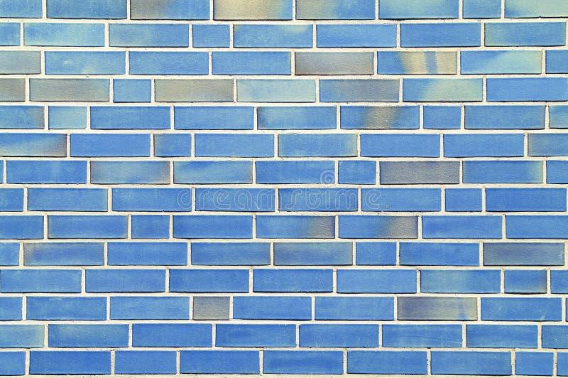 Pared con los ladrillos azules. fotografía de archivo