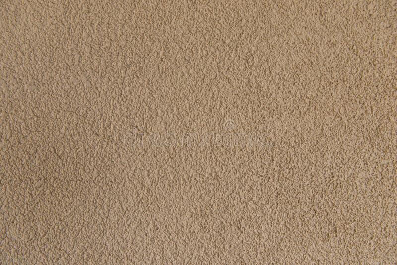 Pared concreta marrón clara del estuco Textura inconsútil del fondo Primer foto de archivo libre de regalías