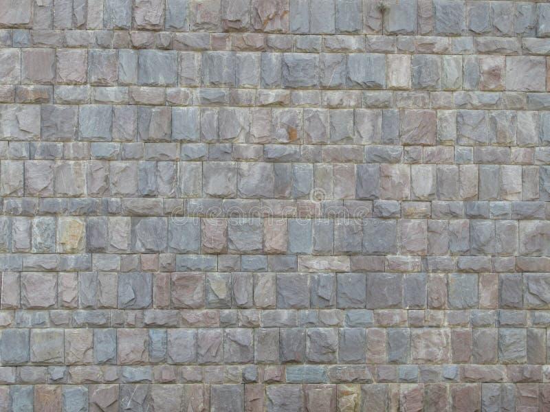 Pared De Bloques De Piedras Grises. Diseño moderno de revestimiento de paredes, ideal para fondos o modelo arquitectónico stock images