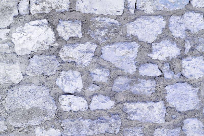 Pared de guijarros grandes La textura de la piedra vieja foto de archivo libre de regalías