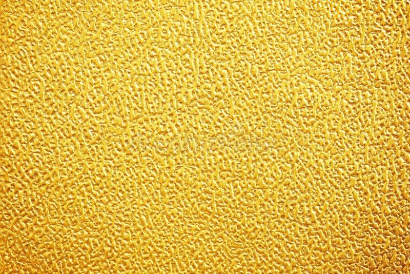 Pared de la textura del oro para el fondo fotos de archivo