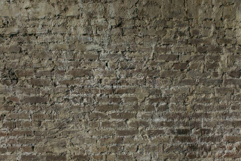 Pared de ladrillo con la albañilería natural del fondo gris del yeso foto de archivo libre de regalías