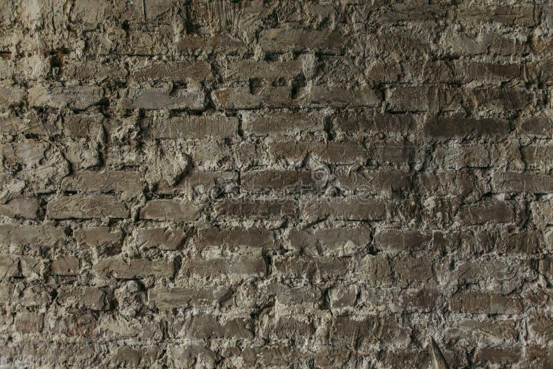 Pared de ladrillo con la albañilería natural del fondo gris del yeso fotografía de archivo