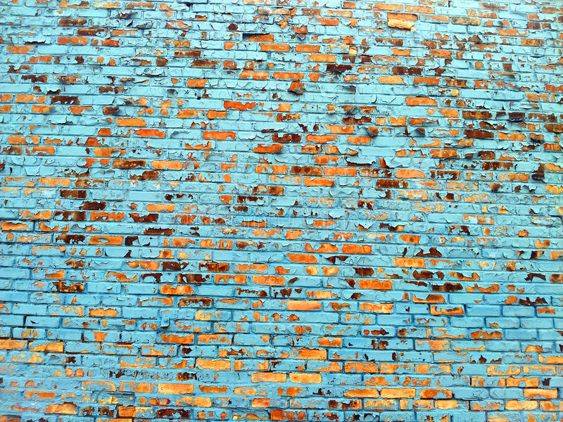 Pared de ladrillo con la pintura azul desconchada foto de for Pintura pared azul grisaceo