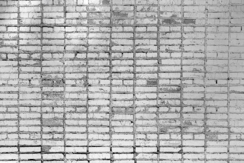 Pared de ladrillo, con las manchas Textura de la albañilería Fondo en blanco hermoso de ladrillos grises fotos de archivo libres de regalías