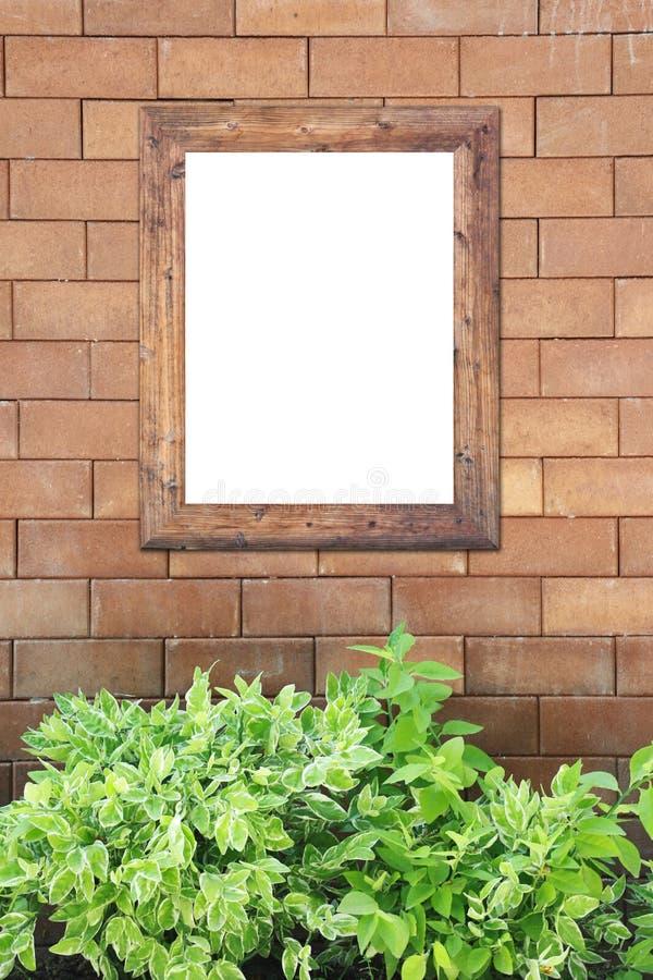 Pared de ladrillo de Brown asqueroso y marco de la foto fotos de archivo libres de regalías