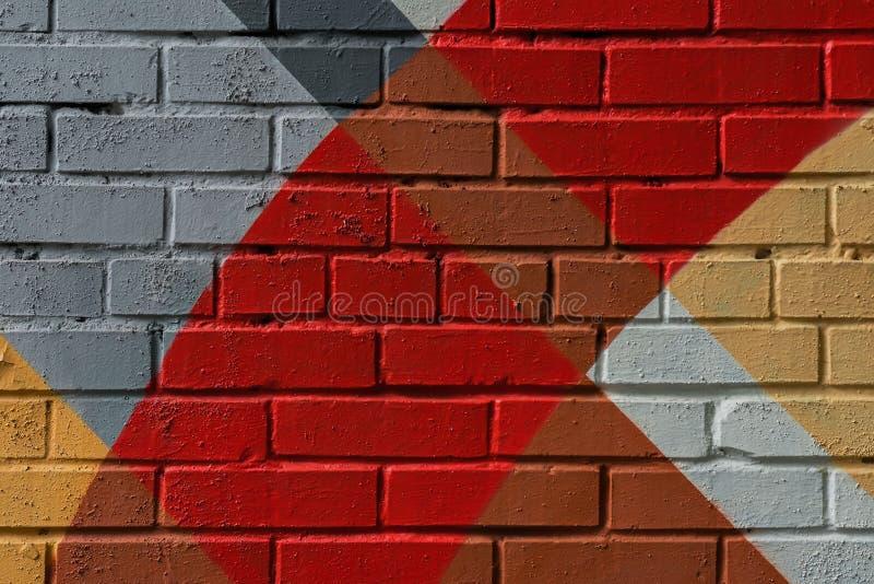 Pared de ladrillo de Graffity, detalle muy pequeño Primer urbano abstracto del arte de la calle, colores de la moda, modelo elega foto de archivo