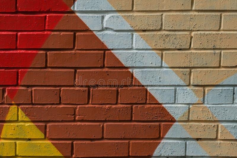 Pared de ladrillo de Graffity, detalle muy pequeño Primer urbano abstracto del diseño del arte de la calle Cultura urbana icónica imagen de archivo