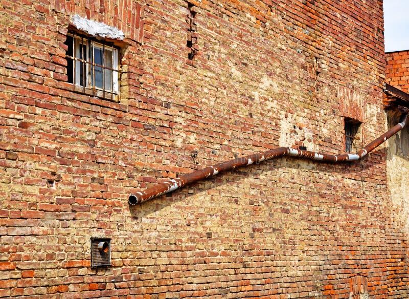 Pared de ladrillo de un edificio viejo fotos de archivo
