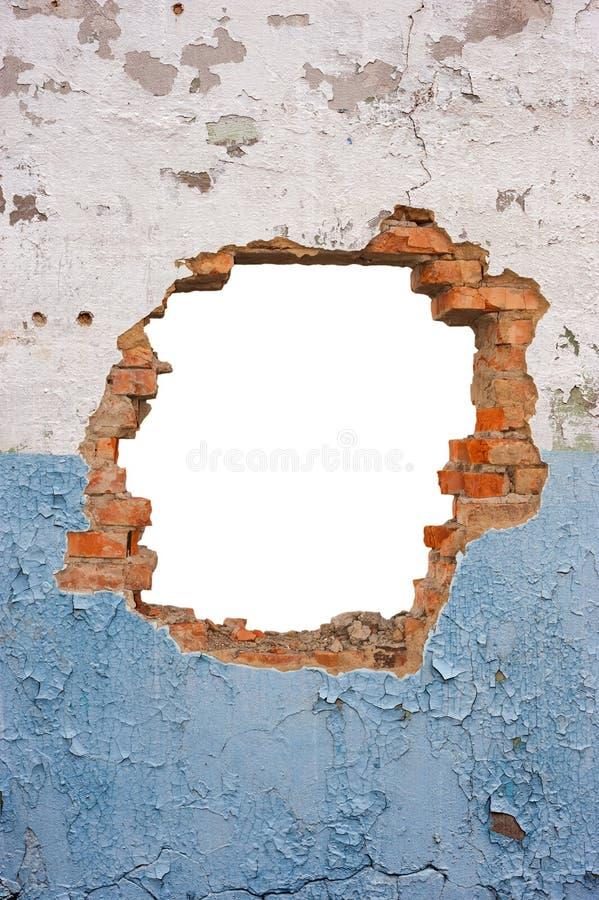Pared de ladrillo del agujero imagenes de archivo