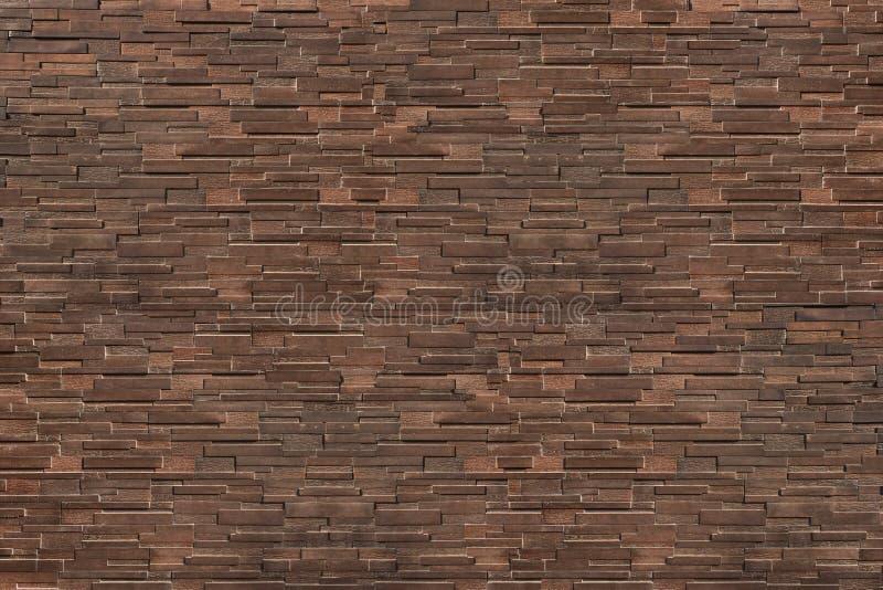 pared de ladrillo moderna del marrón oscuro para el modelo y el fondo imágenes de archivo libres de regalías