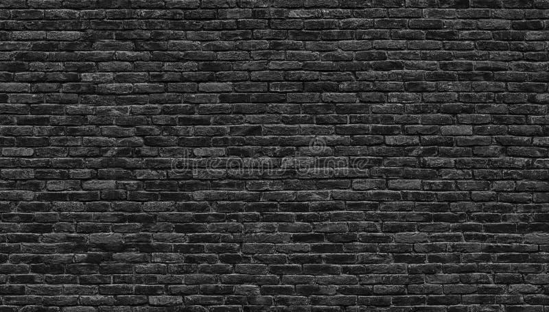 Pared de ladrillo oscura, textura de un fondo negro del ladrillo foto de archivo libre de regalías