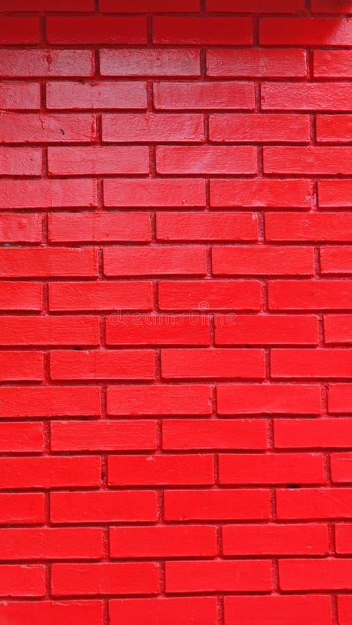 Pared de ladrillo pintada roja fotografía de archivo