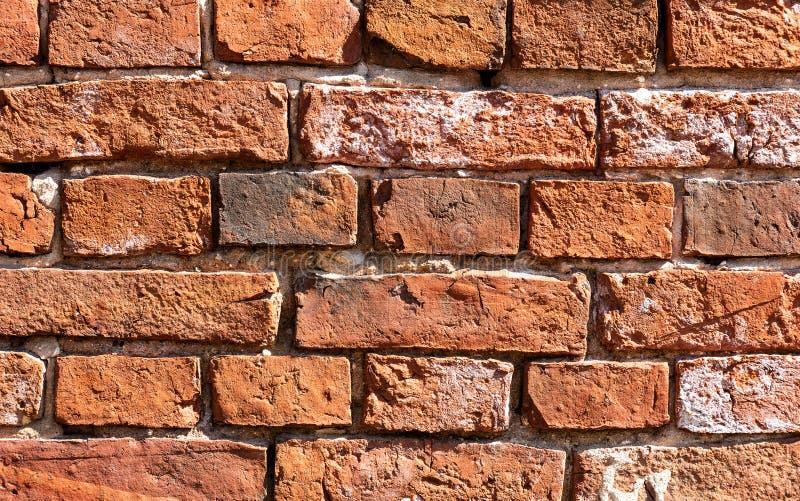 Pared de ladrillo roja resistida Grunge como textura del fondo imagenes de archivo