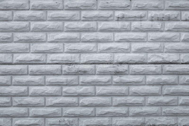Pared de ladrillo sucia gris Modelo retro con la pared de ladrillos gris, fondo del grunge Áspero, textura concreta del vintage,  fotografía de archivo libre de regalías