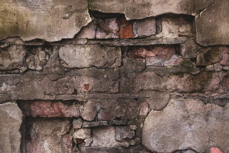 Pared de ladrillo de una casa destruida vieja Modelo abstracto del vintage en textura del cemento Fondo del Grunge Textura del mu fotos de archivo
