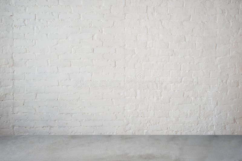 Pared de ladrillo y piso blancos de alta resolución fotografía de archivo