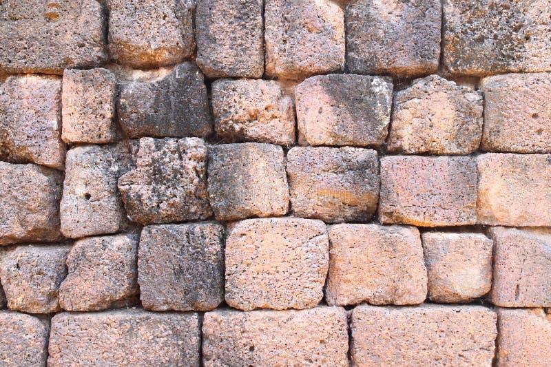 Pared de piedra antigua del castillo imagenes de archivo