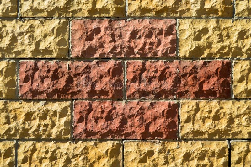 Pared de piedra beige y roja del corte de multa Fondo, textura fotografía de archivo libre de regalías
