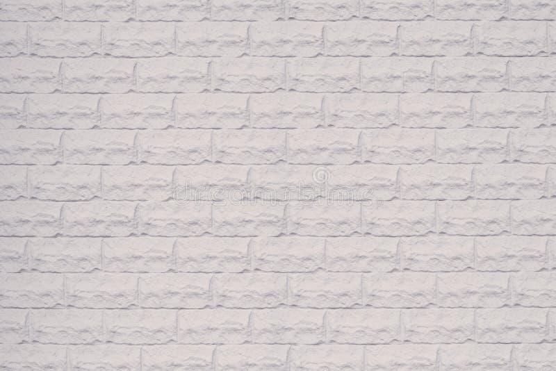 Pared de piedra blanca decorativa Textura blanca de la pared de ladrillo Espacio vac?o Modelo de la pared de ladrillo blanca Pare foto de archivo libre de regalías