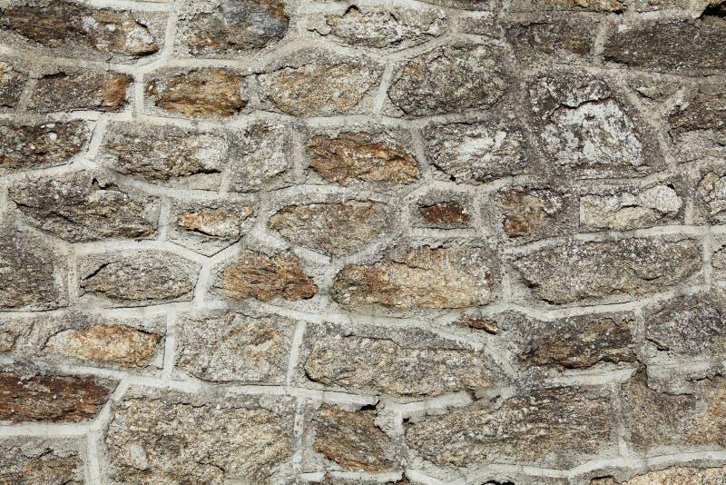 Pared de piedra del granito de la textura del fondo imagenes de archivo