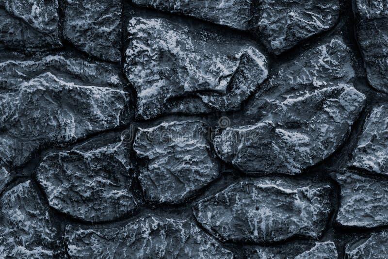 Pared de piedra gris oscuro para el diseño de la decoración Textura de la pared del mármol del fondo del gris Modelo de piedra de imagen de archivo