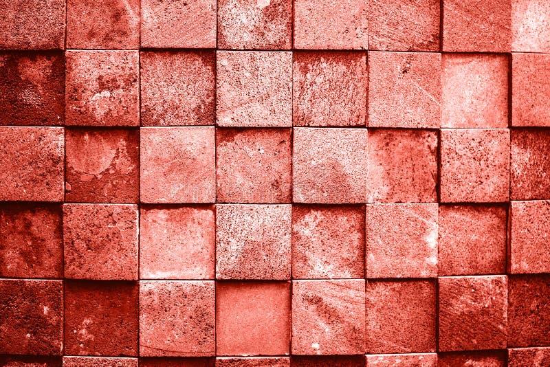 Pared de piedra hecha con los cuadrados fotos de archivo