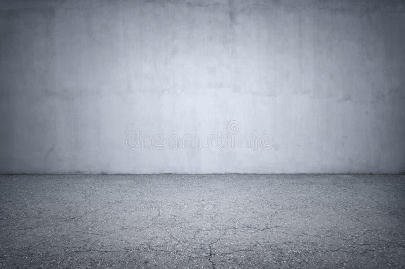 Pared de piedra y piso gris fotografía de archivo