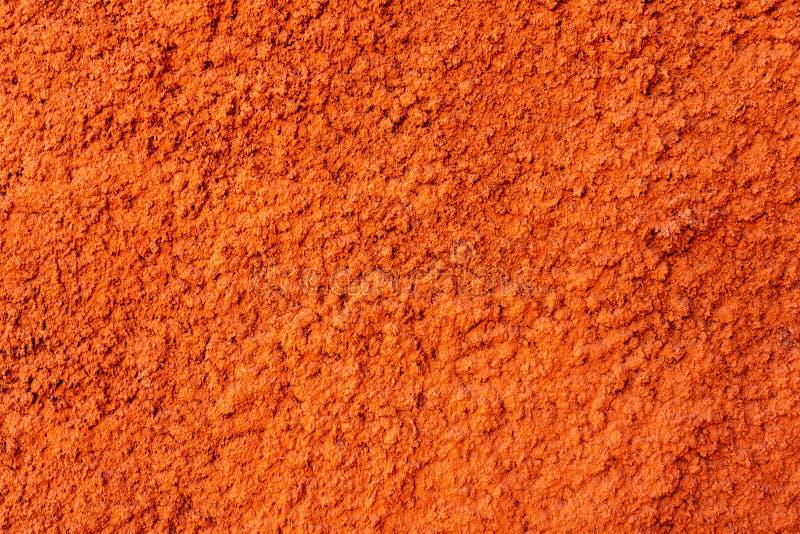 Pared del color anaranjado en yeso decorativo Textura imagen de archivo libre de regalías
