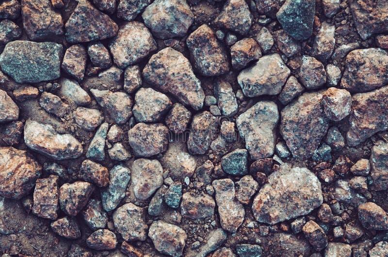 Pared del fondo hecha de piedra Papel pintado gris de la roca Textura abstracta de la playa del mar Copyspace para su texto o anu imagenes de archivo