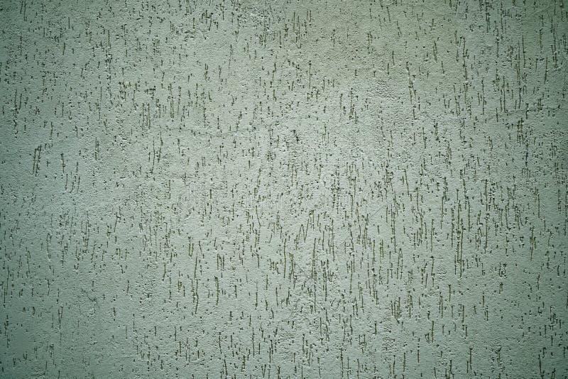 Pared en la calle con el efecto del grunge, textura del cemento, fondo del yeso imagenes de archivo