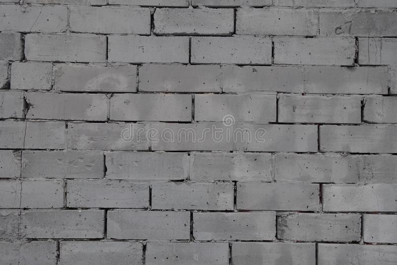 Pared hecha de unidades concretas grises de la albañilería fotografía de archivo