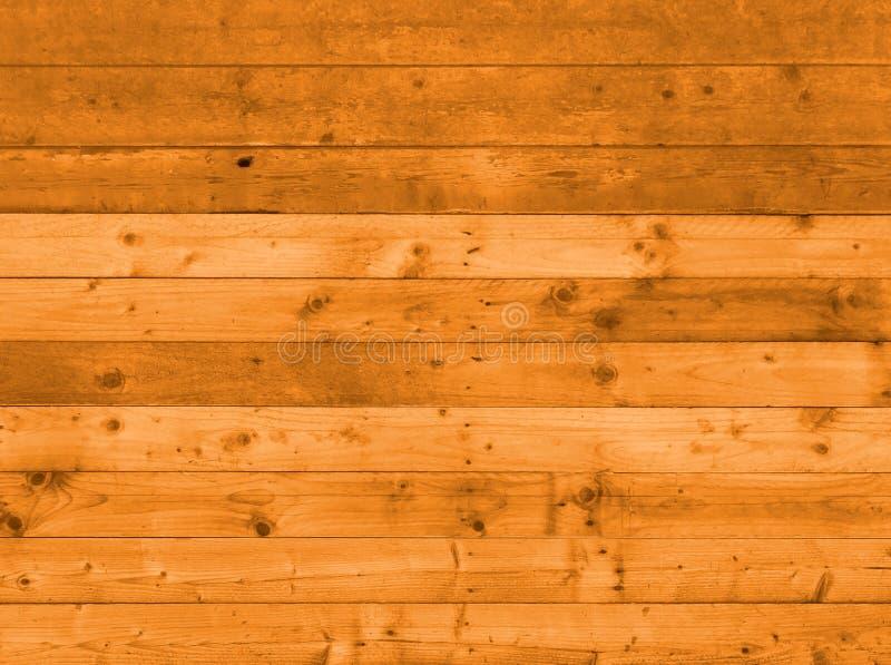 Pared o piso de madera marr?n caliente del tabl?n con los tableros anudados granosos hechos de la madera reutilizada vieja foto de archivo