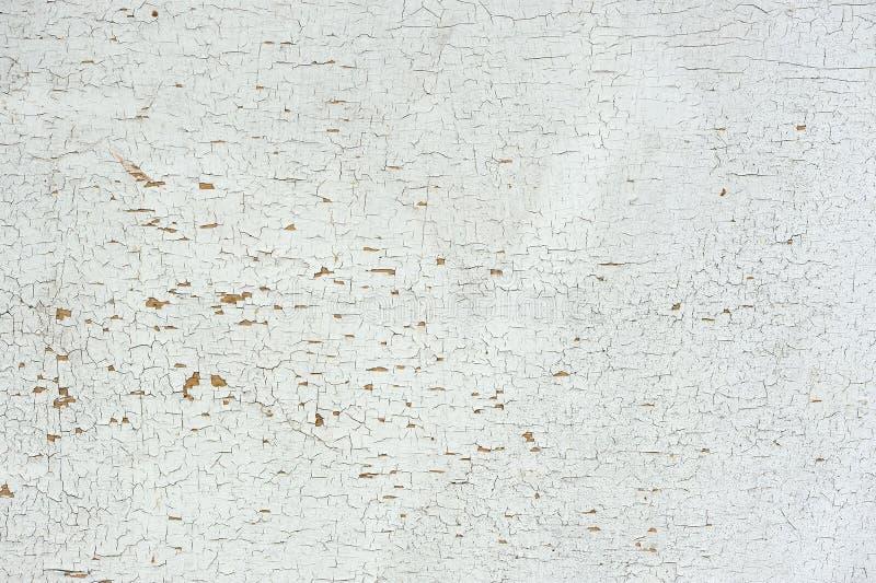 Pared pintada agrietada vieja como fondo imagen de archivo