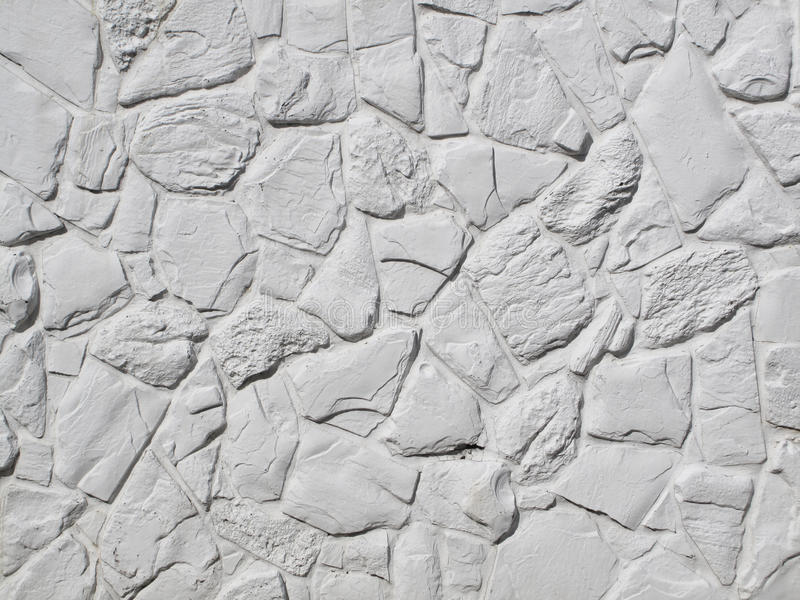 Pared pintada blanco de la roca fotos de archivo libres de regalías