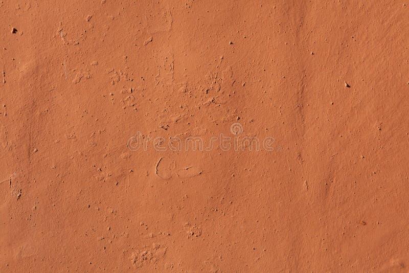 Pared pintada terracota del estuco Textura del fondo foto de archivo