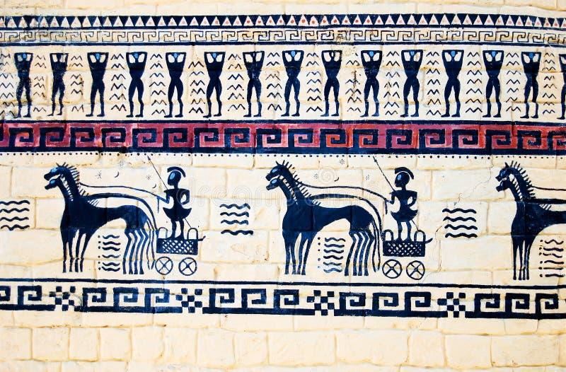 Pared-pintura con los guerreros griegos en los carros con foto de archivo
