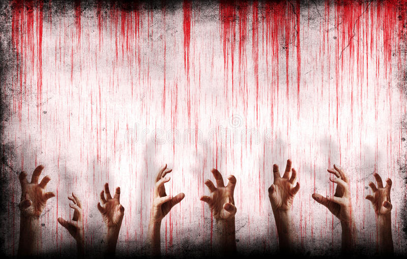 Pared sangrienta con las manos asustadizas fotos de archivo