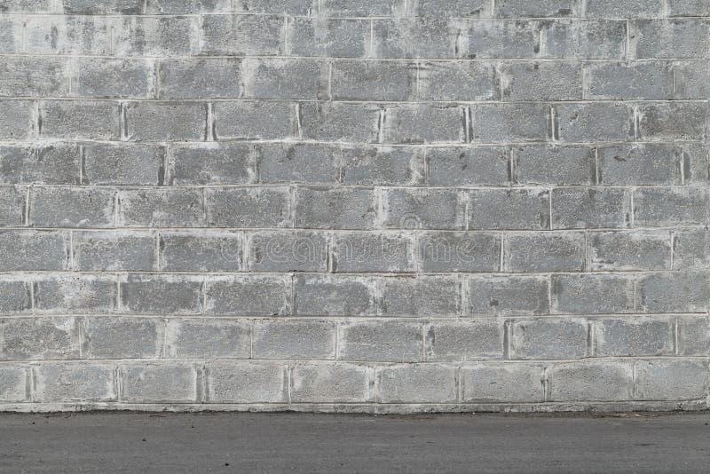 Parede cinzenta feita dos blocos de cimento imagem de stock