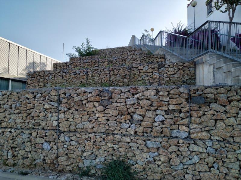 Parede construída com pedras, texturas resistentes imagens de stock royalty free