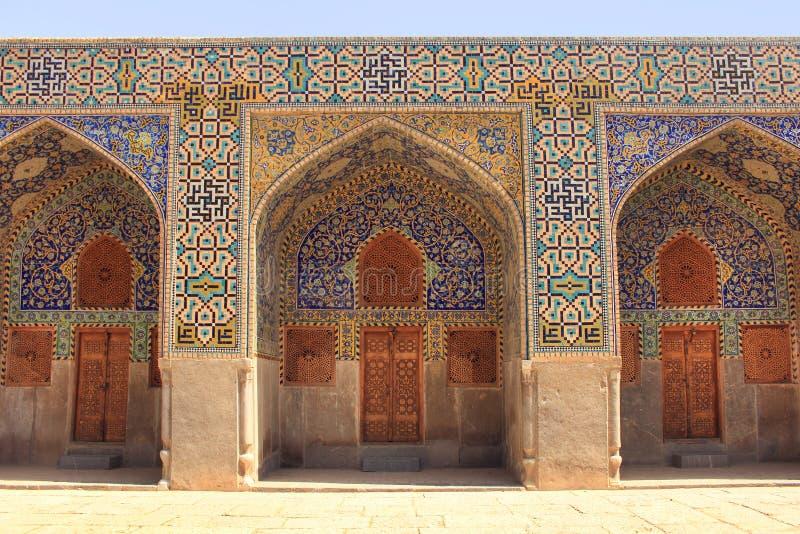 A parede da mesquita do xá (imã Mosque) no quadrado de Naqsh-e Jahan na cidade de Isfahan, Irã imagens de stock