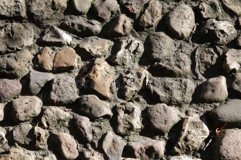 Parede da pedra de pavimentação fotos de stock