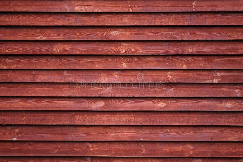 Parede de madeira vermelha foto de stock